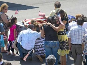 Family members of Alejandro Granado meet his casket at the East Texas Regional Airport.